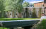 """Yard off Great Room with """"weeping"""" stone sculptural stone wall"""