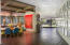 Dining Room off gallery wall to wet bar, central courtyard, and kitchen