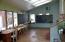Passive solar greenhouse room in school building