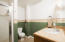 Bathroom 4 is located on the lower level adjacent to family room and 5th bedroom.