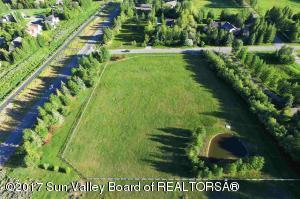 Pond, mountain views, trees, stream, fenced, irrigated, ready to build.