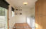 Large Laundry Room, with extra storage and door to back yard