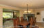 Large and light dining room with gas fireplace