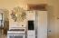 Kitchen detail - Note new gas range, charming tall fridge