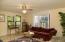 Living room has great juju - lots of light, Bay windows, new wood burning stove