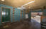 The one-car garage is 360 SF and offers storage and a large pet door to the back yard.
