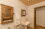 This custom bathroom offers lovely vintage style hardware (the large laundry / utility room is located behind the photographer). The interior of the home has been newly repainted.