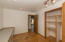 The third bedroom (or office) has custom shelving, a built in desk (removable if you wish), french doors out to the green house, new paint, and refinished solid wood floors.