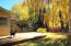 Beautiful back yard with gorgeous Willow tree, large deck, sunshine