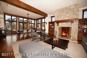 Open living and dinning area - fireplace, West and East facing large terraces.