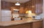 Newer cabinets, appliances and counters, pull a stool up to the eating bar.