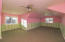 The Watermelon Room - This large bonus room could serve as a bedroom (has large closet with built ins) or fabulous rec room or guest room.