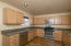 Spacious kitchen with nice counter tops and cupboards