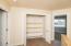 Spacious upstairs closet with built ins