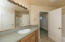 Spacious master bathroom, walk-in closet, vanity, separate WC, and another storage closet