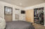Master Bedroom with custom closet built-ins and Barn doors