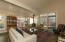 Spacious living room with a large deck, large sliding door and transom windows to let in light and views.