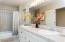Double vanity, tub/shower combo.