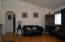 View of living room from Master Bedroom! Archway leads to guest bedrooms for a split floor plan!