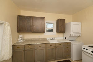 Newly redone kitchen! Includes cabinets and new flooring.