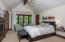 Spacious master bedroom with balcony, mountain, views and individual fireplace