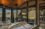 Master Suite with fireplace, covered patio beyond