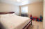 The downstairs bedroom is adjacent to the family room and this combination makes for a terrific guest suite