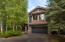 4625 Arrowwood surrounded by beautiful landscaping and mature trees.