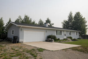 Beautifully kept 3-bedroom, 2-bath, 2-car garage home on 3 acres with water.