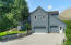 Two car garage with 3d bay separate entrance. Shop space in the rear with half/bath.
