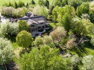 Come see this distinctive property with beautiful landscaping and panoramic mountain views.