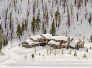 The home nestles into the landscape. Timeless design and architecture. Go to www.peaceofsunvalley.com