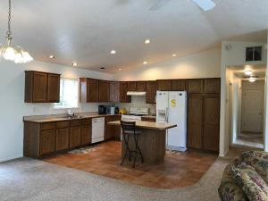 Vaulted ceilings, window above the kitchen sink and a social kitchen island!
