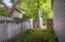 Spacious side yard, backyard completely fenced