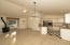 Beautiful new lighting and kitchen appliances, nice slider to patio, great light.
