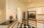 Beautiful new lighting and kitchen appliances (range, stove top, dishwasher).