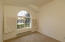 Bedroom offer round windows with wood shutters, and high ceilings, freshly painted