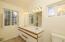 Master bathroom, two sinks, two windows, new linoleum flooring