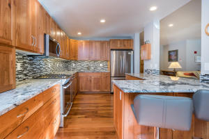 Soft close doors and drawers, pull outs, granite counters, gas range, hardwood floors