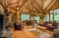with fireplace, vaulted ceilings and log beams