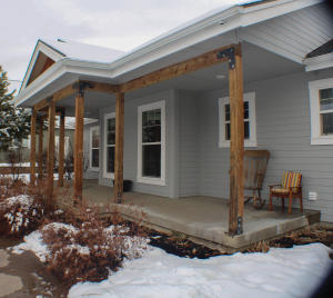 Front entry & Inviting covered porch. Faces West.