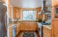 Enjoy the mountain views while cooking or entertaining, granite slab counters, very functional kitchen with abundance of cabinets