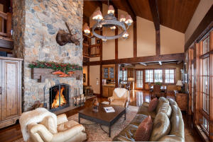 2 story ceilings surrounded by natural light. Rumford fireplace and Colorado 7 stone