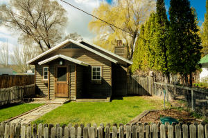 """Picket fence surrounds your front yard to this darling """"Like New"""" cabin."""