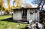 Storage shed is solid and offers electricity and ample storage.
