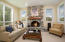 Bright & airy with a cozy wood burning fireplace. Wood carpeting.