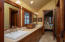 This bathroom is a jack and jill for bedrooms 4 and 5 with a walk in shower.