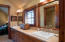 This bathroom is a jack and jill for rooms 2 and 3. Tub shower combo with a jetted tub.