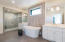 Spa like master bath with soaking tub, rain shower, towel warmer, his/her vanity and walk in closets.