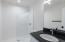 This beautifully fun bathroom is in located off the Bonus Room. Walk in shower and granite vanity.